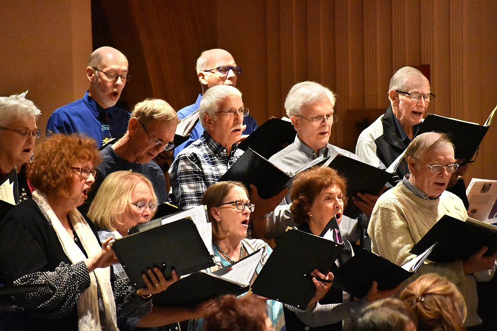 "The St. Luke's Episcopal and United Methodist church choirs joined together to sing during the 2018 Celebration of Thanks concert held Nov. 15 at St. Luke's Episcopal Church in Prescott. The interfaith choir was under the direction of Dennis Houser (St. Luke's) and Jacob Gilbert (UMC). The annual event, called ""Many Voices of Thanks,"" brings together choirs, musicians, dancers and speakers from many faith beliefs and is sponsored by the Quad City Interfaith Council. (Richard Haddad/WNI)"