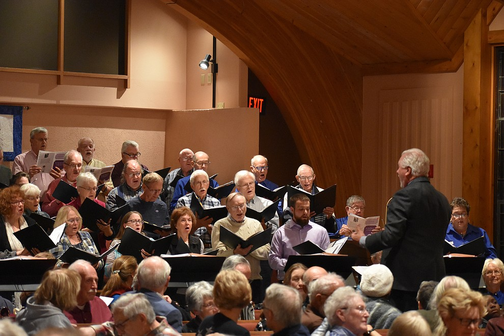 "Dennis Houser directs the St. Luke's Episcopal and United Methodist church combined choirs during the 2018 Celebration of Thanks concert held Thursday, Nov. 15 at St. Luke's Episcopal Church in Prescott. The annual event, called ""Many Voices of Thanks,"" brings together choirs, musicians, dancers and speakers from many faith beliefs and is sponsored by the Quad City Interfaith Council. (Richard Haddad/WNI)"