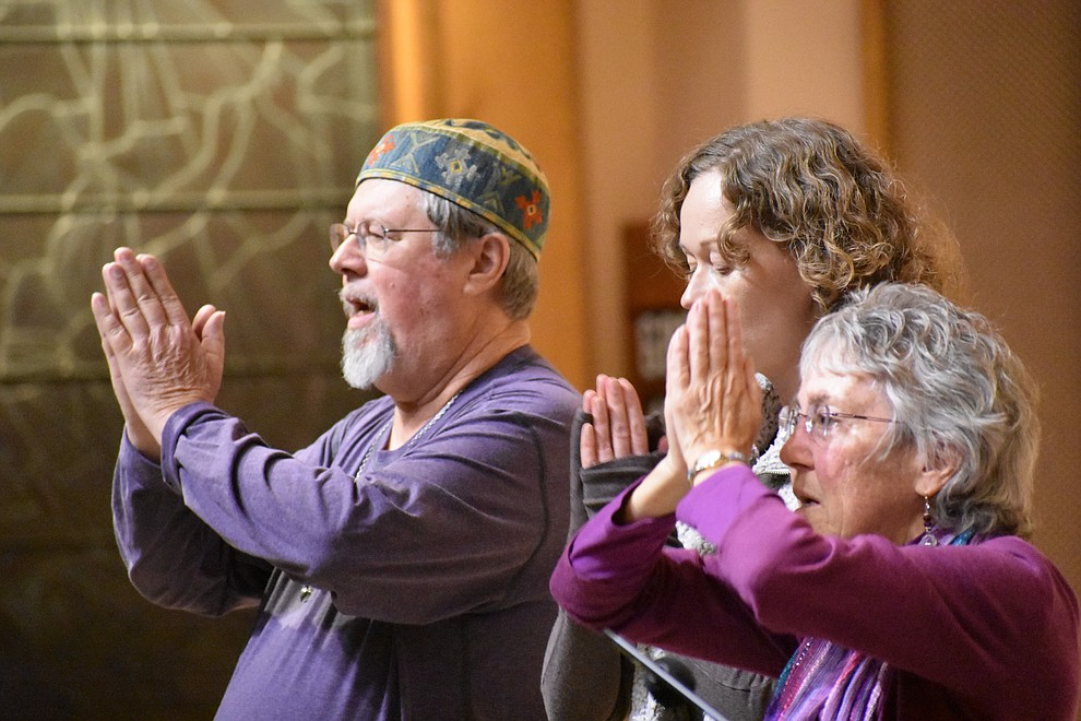 "Members of Prescott Sufi Circle perform a Sufi dance and prayer song called, ""My House Shall Be a House of Prayer for All"" during the 2018 Celebration of Thanks concert held Thursday, Nov. 15 at St. Luke's Episcopal Church in Prescott. The annual event, called ""Many Voices of Thanks,"" brings together choirs, musicians, dancers and speakers from many faith beliefs and is sponsored by the Quad City Interfaith Council. (Richard Haddad/WNI)"