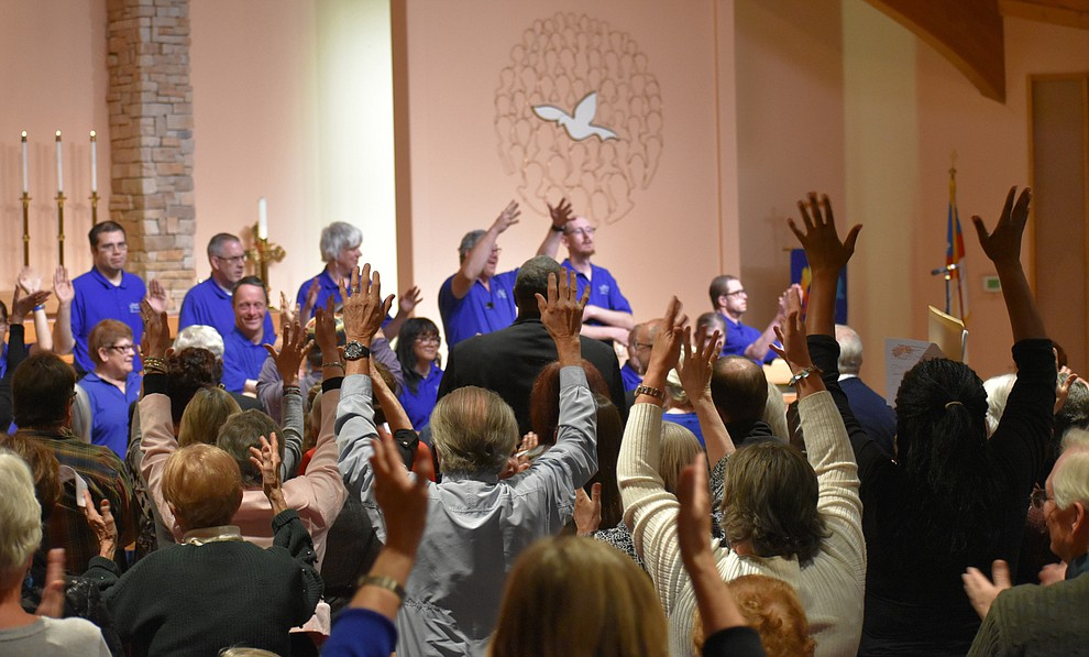 "The audience stands and signs applause for the ""Beautiful Singers"" sign language choir from American Lutheran Church. The chior performed during the 2018 Celebration of Thanks concert held Thursday, Nov. 15 at St. Luke's Episcopal Church in Prescott. The annual event, called ""Many Voices of Thanks,"" brings together choirs, musicians, dancers and speakers from many faith beliefs and is sponsored by the Quad City Interfaith Council. (Richard Haddad/WNI)"