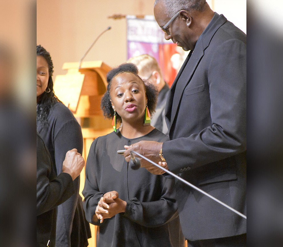 "Mmbers of the St. Luke Ebony Choir prepare to sing during the 2018 Celebration of Thanks concert held Thursday, Nov. 15 at St. Luke's Episcopal Church in Prescott. The annual event, called ""Many Voices of Thanks,"" brings together choirs, musicians, dancers and speakers from many faith beliefs and is sponsored by the Quad City Interfaith Council. (Richard Haddad/WNI)"