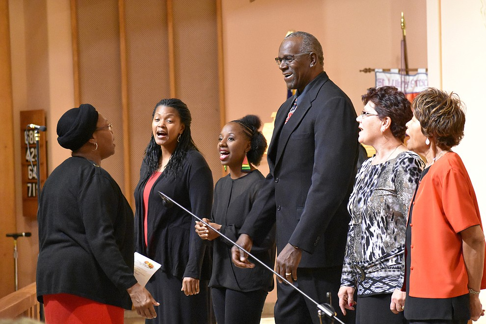 "The St. Luke Ebony Choir performs during the 2018 Celebration of Thanks concert held Thursday, Nov. 15 at St. Luke's Episcopal Church in Prescott. The annual event, called ""Many Voices of Thanks,"" brings together choirs, musicians, dancers and speakers from many faith beliefs and is sponsored by the Quad City Interfaith Council. (Richard Haddad/WNI)"