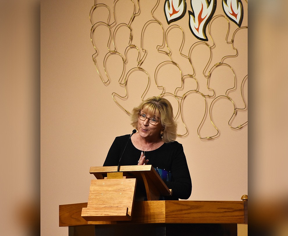 "Liz Kennedy of the Quad City Interfaith Council acts as emcee during the 2018 Celebration of Thanks concert held Thursday, Nov. 15 at St. Luke's Episcopal Church in Prescott. The annual event, called ""Many Voices of Thanks,"" brings together choirs, musicians, dancers and speakers from many faith beliefs and is sponsored by the QCIC. (Richard Haddad/WNI)"
