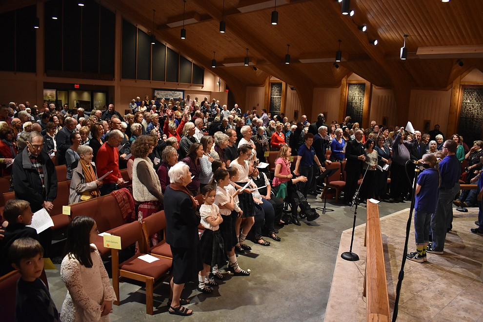"The audience stands for the closing song of ""Let There Be Peace on Earth"" during the 2018 Celebration of Thanks concert held Thursday, Nov. 15 at St. Luke's Episcopal Church in Prescott. The annual event, called ""Many Voices of Thanks,"" brings together choirs, musicians, dancers and speakers from many faith beliefs and is sponsored by the Quad City Interfaith Council. (Richard Haddad/WNI)"
