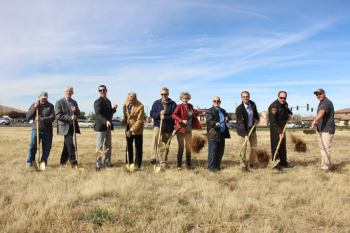 Dunkin' Donuts franchisee Paul Faust (third from right) celebrates a groundbreaking of the chain's soon-to-be Prescott Valley location with town officials, property developers and local builders. (Max Efrein/Courier)