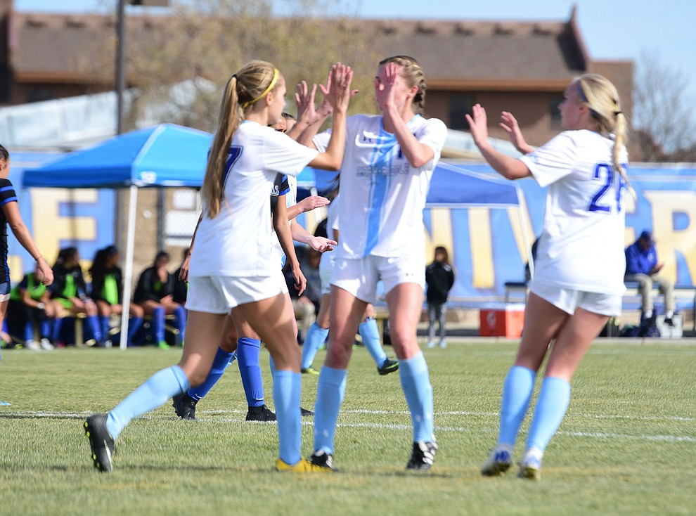 Embry Riddle players celebrate Maddy Mak's penalty kick goal as the Eagles take on Hope International in the first round of the NAIA National Championship Tournament in Prescott Saturday, November 17, 2018. (Les Stukenberg/Courier).