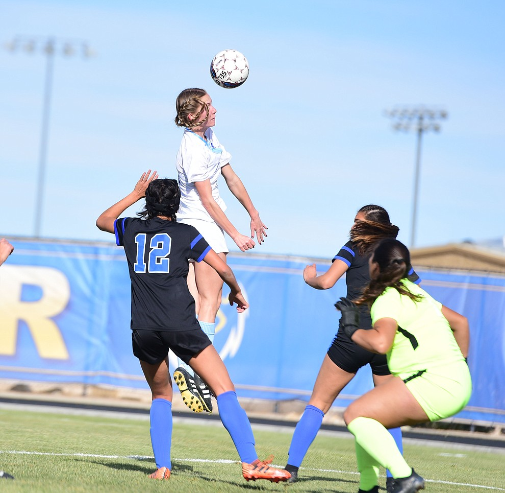 Embry Riddle's Breanna Larkin heads the ball off a corner kick as the Eagles take on Hope International in the first round of the NAIA National Championship Tournament in Prescott Saturday, November 17, 2018. (Les Stukenberg/Courier).