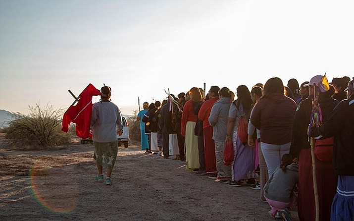 Pam Thomson carried the red dress representing missing and murdered indigenous women as the group prepares to leave on the second day of the annual Women's Prayer Run. (Photo by Carly Henry/Cronkite News)