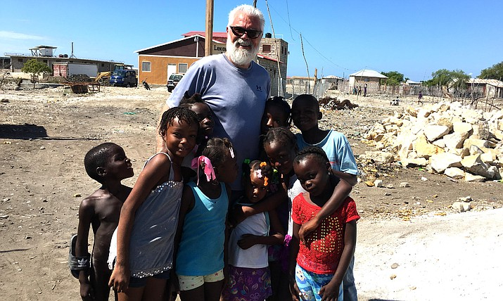 Doug Freeman with Jubilee Kids' students.  Under the umbrella of Jubilee Kids (www.jubileekidsinc.org) there is a school that is staffed with all Haitian teachers, serving over 180 kids from pre-school to 8th grade. Manzanita Outreach courtesy photo