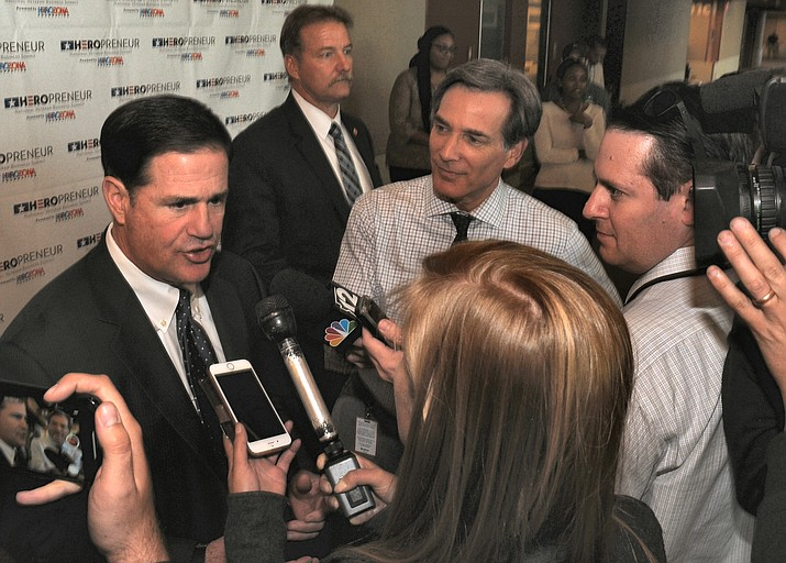 "Gov. Doug Ducey chat with reporters Friday about an ""audit"" being launched by the state Republican Party into allegations of voting irregularity in Maricopa County. (Capitol Media Services photo by Howard Fischer)"