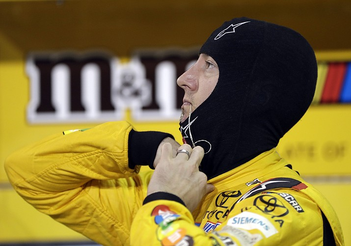 Kyle Busch prepares to get into his car during qualifying for the NASCAR Cup Series auto race at Homestead-Miami Speedway, Friday, Nov. 16, 2018, in Homestead, Fla. (Lynne Sladky/AP)