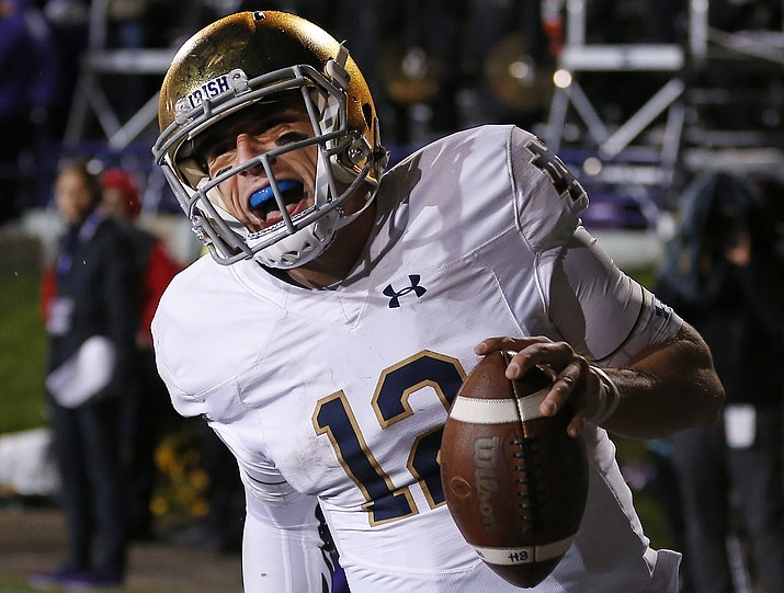 In this Saturday, Nov. 3, 2018, file photo, Notre Dame's Ian Book celebrates as he scores a touchdown against Northwestern during the second half of an NCAA college football game in Evanston, Ill. Third-ranked Notre Dame will put its unbeaten record on the line when it faces No. 12 Syracuse at New York's Yankee Stadium on Saturday. (Jim Young/AP, file)