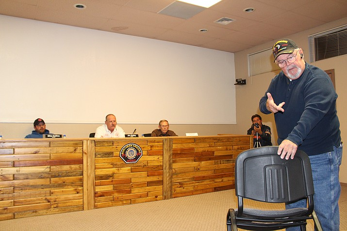 Rick Veradt takes his chair with him to chastise the Northern Arizona Consolidated Fire District board for making the public leave the room for a closed session meeting Thursday. (Photo by Hubble Ray Smith/Daily Miner)