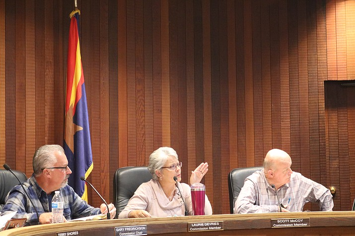 The Planning and Zoning Commission looks to City-provided maps and data to help in its decision regarding a rezoning of property off of Slaughterhouse Canyon Road. (Photo by Travis Rains/Daily Miner)