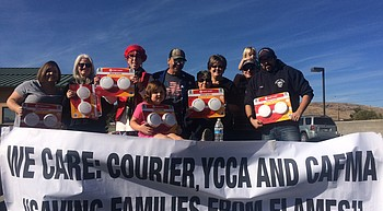 Photo: YCCA, State Farm, CAFMA team with 'Courier Cares' to give away smoke alarms photo