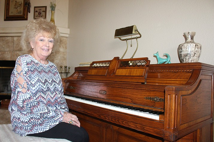Sue Wilkin sits at the piano at her home in Valle Vista. She was elected to the Northern Arizona Consolidate Fire District board of governors on Nov. 6, returning to her former position after being forced to resign for conflict-of-interest charges. (Photo by Hubble Ray Smith/Daily Miner)