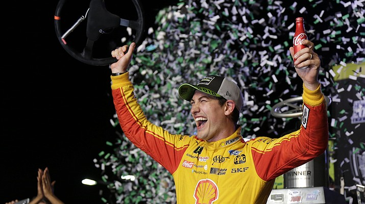 Logano outduels 'Big 3' to win NASCAR title