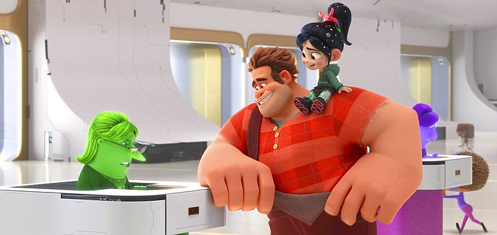 """This image released by Disney shows characters, from left, eBay Elayne, voiced by Rebecca Wisocky, Ralph, voiced by John C. Reilly and Vanellope von Schweetz, voiced by Sarah Silverman in a scene from """"Ralph Breaks the Internet."""" (Disney via AP)"""