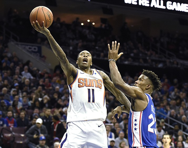 Phoenix Suns' Jamal Crawford (11) drives to the basket past Philadelphia 76ers' Jimmy Butler (23) in the first half of an NBA basketball game, Monday, Nov. 19, 2018, in Philadelphia. (Michael Perez/AP)