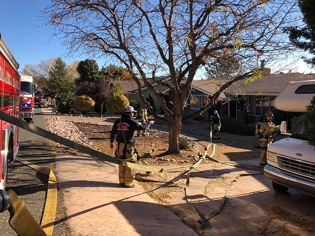 Central Arizona Fire and Medical Authority personnel fight an attic fire at a home in Dewey Monday morning, Nov. 19.