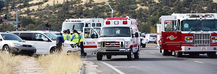 Emergency personnel respond to a fatal vehicle accident on Highway 69 in front of the Frontier Village Shopping Center in Prescott Friday, Nov. 16.
