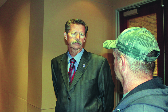 Ron Gould, left, elected Nov. 6 as Mohave County District 5 Supervisor, speaks with Robert Smith of the Mohave County Public Lands and Recreation Commission prior to Monday's Board of Supervisors meeting. (Photo by Hubble Ray Smith/Daily Miner)