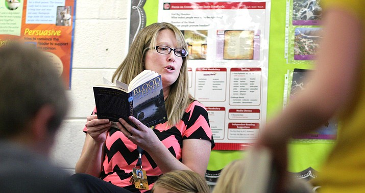 "Mountain View Preparatory's Sarah O'Donnal reads to her class recently. ""I belong in the classroom and would not want to be anywhere else,"" the fifth grade teacher says. VVN/Bill Helm"