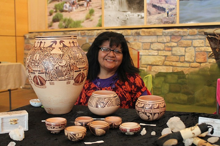Delaine Tootsie-Chee demonstrates and displays Hopi pottery during Grand Canyon's Native American Heritage Month celebration Nov. 14. (Erin Ford/WGCN)