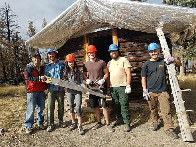 Students work with Kaibab National Forest employees to help stabilize the historic Kendrick Mountain Lookout Cabin located on the mountain. (Photo/Kaibab National Forest)