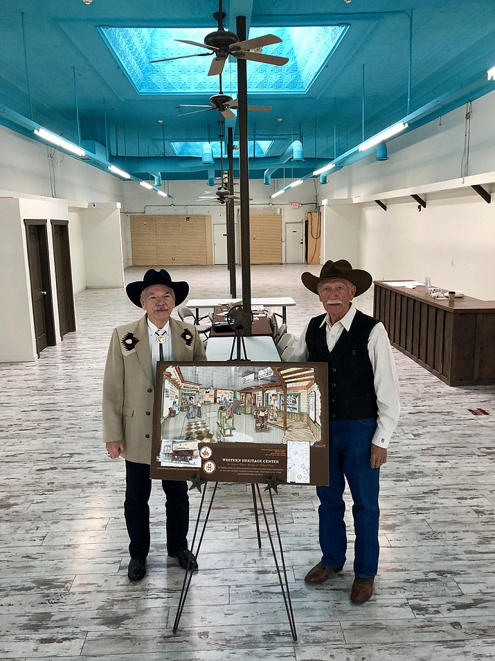 Western Heritage Foundation President Dennis Gallagher, left, and Foundation Vice President Robert Greninger, right, show an artist's rendering of the interior of the Western Heritage Center that is being planned in the former Rancher's Wife space on Whiskey Row. Gallagher and Greninger say the new Western Heritage Center should be open to the public by early 2019. (Cindy Barks/Courier)