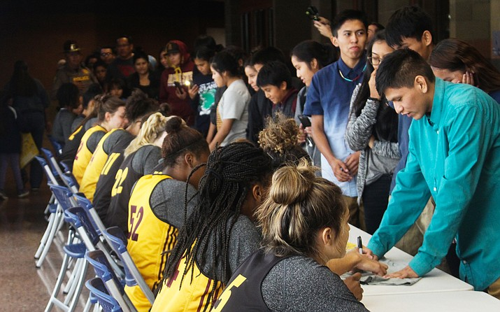 Several thousand fans on the Navajo Reservation lined up for autographs when the Arizona State women's basketball team visited Fort Defiance to play a basketball game against Baylor. (Photo by Sam Ficarro/Cronkite News)