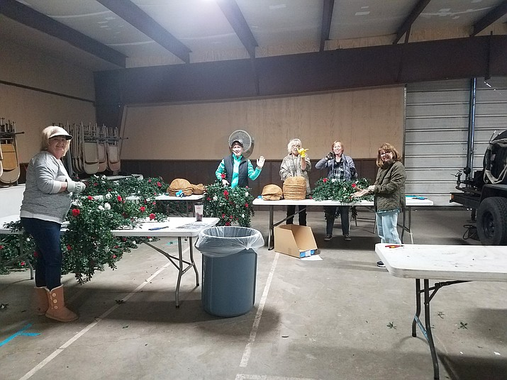 Carole Douglas, Pat Anthony, Sue Bertram, Libby Beatty, Jill Hudson and Kerry-Lynn Moede volunteer to redo the flower baskets that hang along Route 66 Nov. 10. (Submitted photo)