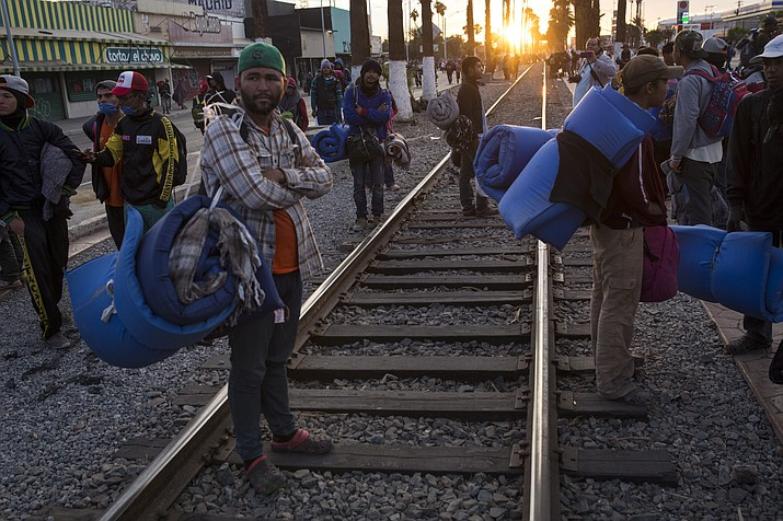 Central American migrants, part of the Central American caravan trying to reach the United States, continue their their journey as they prepare to leave Mexicali, Mexico, Tuesday, Nov. 20, 2018. Tensions have built as nearly 3,000 migrants from the caravan poured into Tijuana in recent days after more than a month on the road, and with many more months likely ahead of them while they seek asylum in the U.S. (Rodrigo Abd/AP)