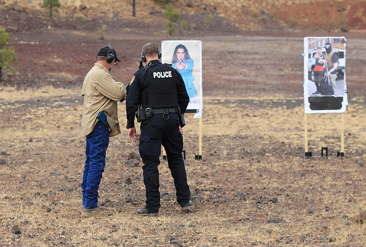 Williams Police Department demonstrates using a gun mounted camera at the Williams Police range Nov. 30, 2017. The Williams Police Department is now implementing the cameras on their service weapons. (Wendy Howell/WGCN)