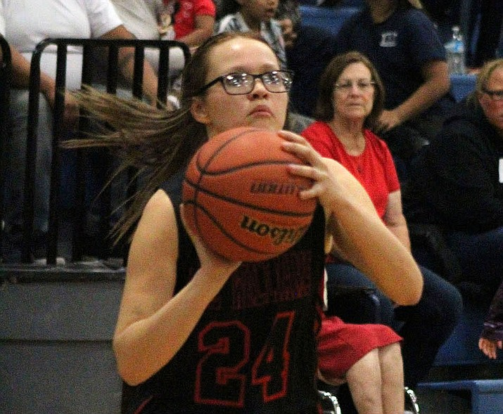 Liberty Cronk scored nine of her game-high 14 points in the second half Tuesday as Lee Williams defeated Kingman High 53-39 (Photo by Beau Bearden/Daily Miner)