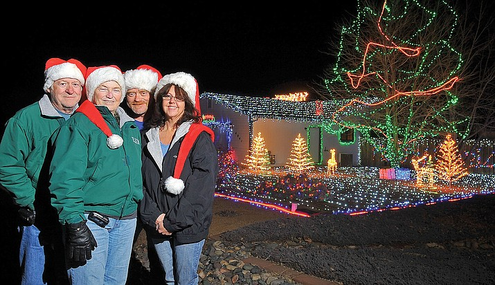 From Dec. 21, 2011, Tom, Helen, and Bryan Radcliff and Dreama Clarke gather together in front of their Prescott Valley home Wednesday night. (Courier file photo)