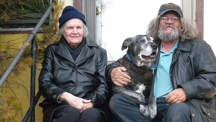 Daniel Mattson with his wife, Grace, and their dog, Duke, at their now home in downtown Prescott. The couple rented the home for 10 years before purchasing it through the assistance of more than 100 community donors who enabled them to secure a mortage for the property. (Courtesy)