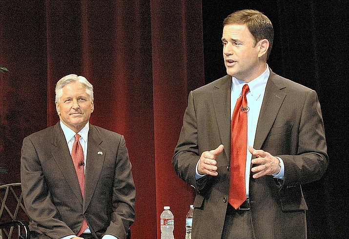 Republican Doug Ducey, left, and Democrat Fred DuVal at a 2014 debate where the GOP gubernatorial contender criticized his foe for tuition increases that occurred under his watch on the Board of Regents. (Howard Fischer/Capitol Media Services)