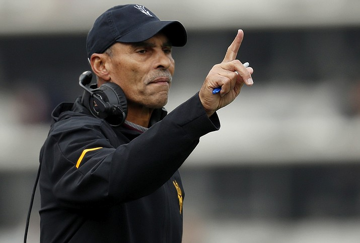 In this Saturday, Oct. 6, 2018, file photo, Arizona State head coach Herm Edwards gestures during the first half of an NCAA college football game in Boulder, Colo. Arizona State's first season under coach Herm Edwards has been a solid one. The Sun Devils beat some good teams, lost some close games and are bowl eligible.  (David Zalubowski/AP, File)