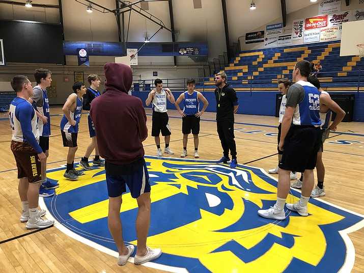 The Prescott Badgers boys basketball team huddles up before practice on Nov. 19, 2018, at Prescott High School. (Chris Whitcomb/Courier)