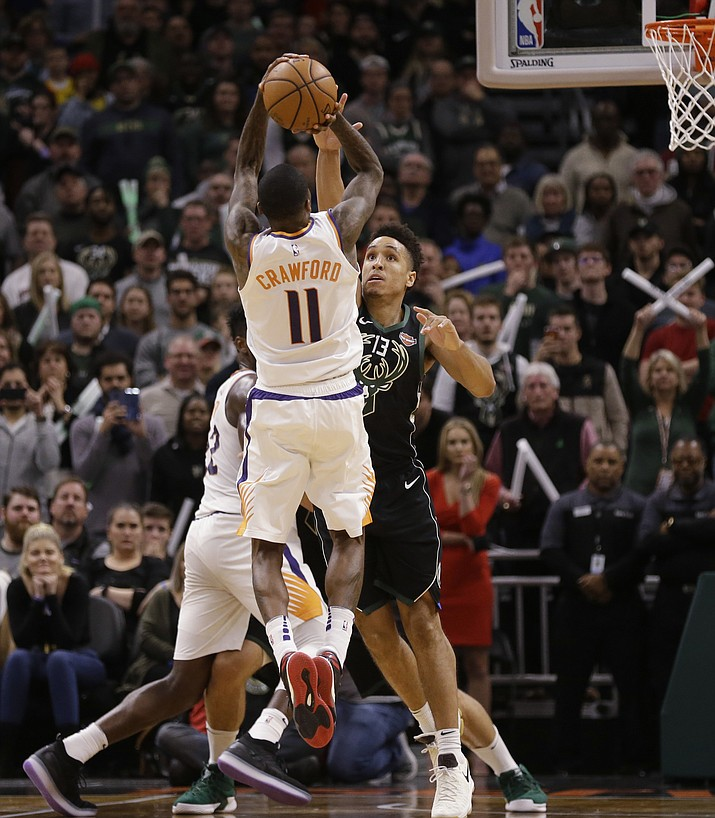Phoenix Suns' Jamal Crawford (11) hits the game-winning shot over Milwaukee Bucks' Malcolm Brogdon during the second half of an NBA basketball game Friday, Nov. 23, 2018, in Milwaukee. The Suns won 116-114. (Jeffrey Phelps/AP)