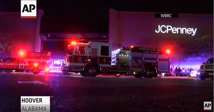 Police responding to a fight inside an Alabama shopping mall shot and killed a man who had brandished a weapon, authorities said Friday. Two other people were injured, including a 12-year-old girl.(Photo capture via AP video)
