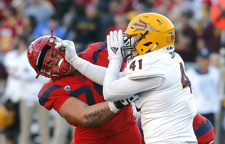 Arizona State defensive lineman Tyler Johnson (41), right, in the second half during an NCAA college football game against Arizona, Saturday, Nov. 24, 2018, in Tucson, Ariz. Arizona State defeated Arizona 41-40 to claim the Territorial Cup. (Rick Scuteri/AP)