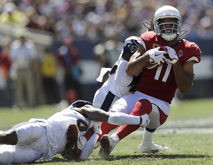 Arizona Cardinals wide receiver Larry Fitzgerald, right, is tackled during the first half of an NFL football game in Los Angeles on Sept. 16, 2018. Fitzgerald (1,276 career receptions) needs six catches to pass Jerry Rice for most receptions in NFL history with one team. (Marcio Jose Sanchez/AP, File)