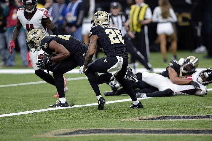 New Orleans Saints cornerback Eli Apple recovers a fumble at their goal line in the second half of an NFL football game against the Atlanta Falcons in New Orleans, Thursday, Nov. 22, 2018. (Bill Feig/AP)