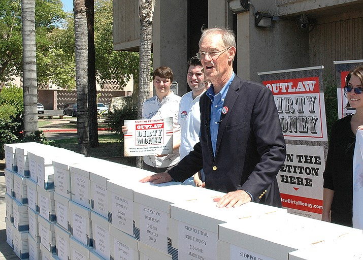"Former Attorney General Terry Goddard in July submitting petitions to put a ban on ""dark money"" into the Arizona Constitution. The Arizona Supreme Court blocked the measure from going on the ballot after signatures gathered by some circulators were disqualified. (Capitol Media Services file photo by Howard Fischer)"