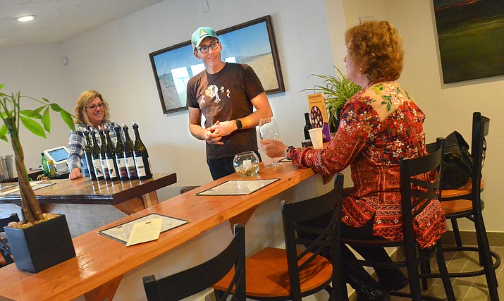Michael Pierce of Clarkdale was pouring his wine for a customer last Friday.VVN/Vyto Starinskas