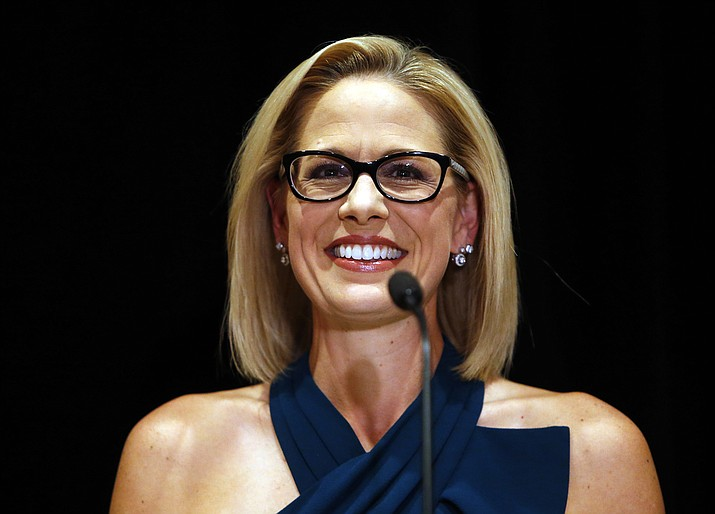 U.S. Sen.-elect Kyrsten Sinema, D-Ariz., smiles after her victory over Republican challenger U.S. Rep. Martha McSally in Scottsdale. (Rick Scuteri/AP)