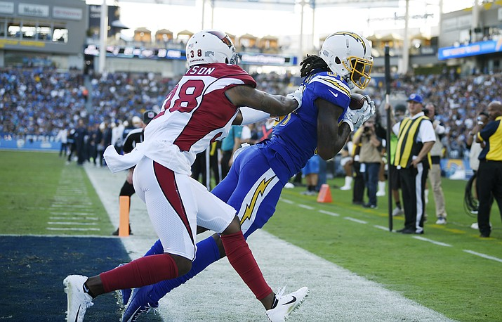 Los Angeles Chargers wide receiver Mike Williams, right, makes a touchdown catch next to Arizona Cardinals defensive back David Amerson during the first half of an NFL football game Sunday, Nov. 25, 2018, in Carson, Calif. (Kelvin Kuo/AP)