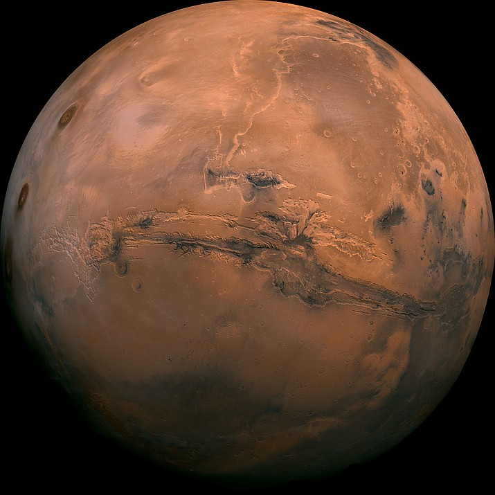 This image made available by NASA shows the planet Mars. This composite photo was created from over 100 images of Mars taken by Viking Orbiters in the 1970s. In our solar system family, Mars is Earth's next-of-kin, the next-door relative that has captivated humans for millennia. The attraction is sure to grow on Monday, Nov. 26 with the arrival of a NASA lander named InSight. (NASA via AP, File)